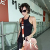 http://celebrity-bags.com/celebrity_bags/victoria-beckham-and-vuitton-monogram-denim-sunrise-in-orange