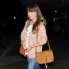 http://celebrity-bags.com/celebrity_bags/olivia-wilde-with-a-casual-gucci-marrakech-handbag