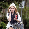 Dakota Fanning Saving Her Outfit With A Balenciaga Handbag