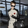 http://celebrity-bags.com/burberry/emma-watson-with-burberry-handbag